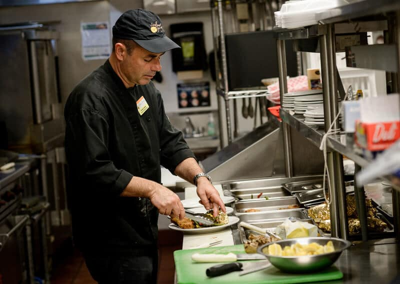 Chef preparing meals for assisted living residents