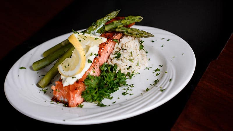 Salmon with asparagus rice and garnish