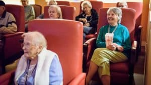 Senior group watching movie in theater