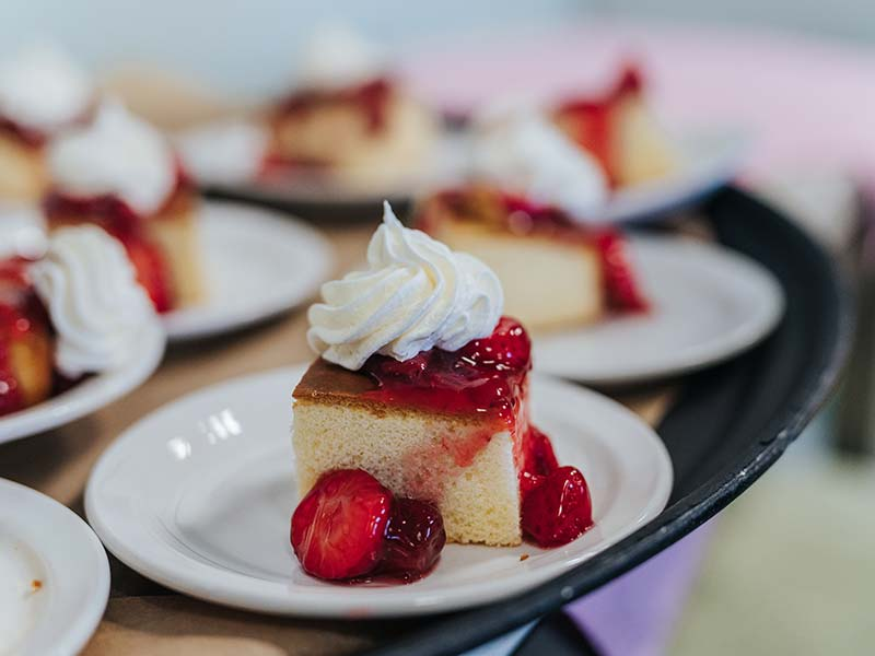 Strawberry shortcake with whipped cream and fresh strawberries