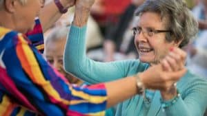 Woman embracing senior woman